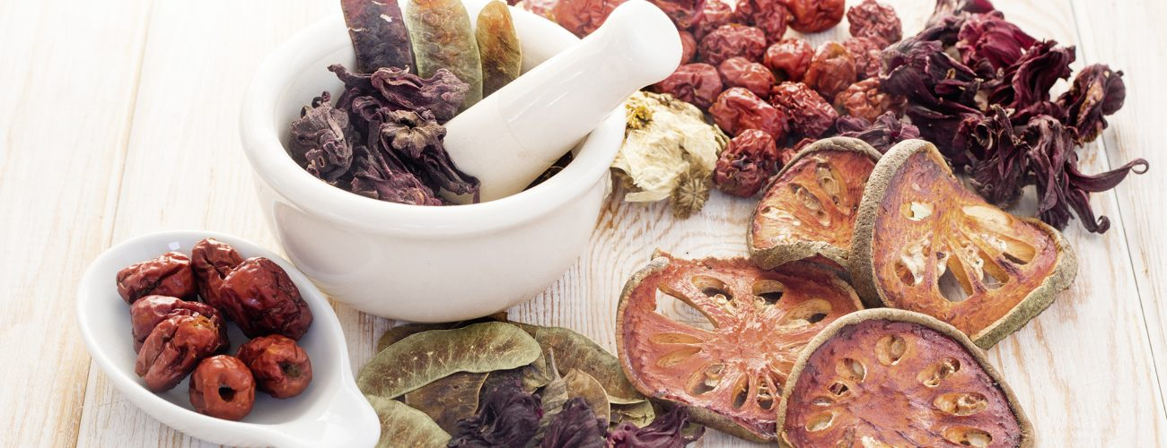 Ingredients for Chinese herbal soup on wood background